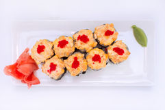 Baked sushi with ginger and wasabi on a black plate Stock Images