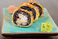 Baked sushi rolls served on blue plate Royalty Free Stock Images