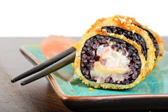 Baked sushi rolls served on turquoise plate Stock Photos