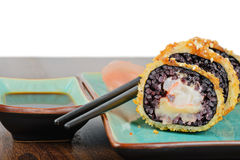 Baked sushi rolls served on turquoise plate Royalty Free Stock Photo