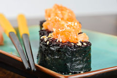Baked sushi rolls served on turquoise plate Royalty Free Stock Image