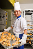Baked sweet bread. Baker holding the sweet bread fresh from the oven Royalty Free Stock Photos
