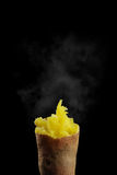 Baked sweet potato. Delicious baked sweet potato isolated on a black background Royalty Free Stock Image