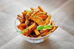 Baked Sweet potato. Sweet potato in a bowl with basil Stock Photography