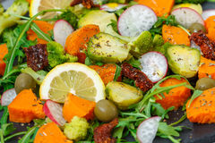 Baked sweet potato, broccoli and other vegetables salad royalty free stock image