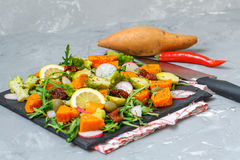 Baked sweet potato, broccoli and other vegetables salad stock photos