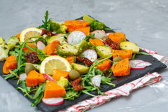 Baked sweet potato, broccoli and other vegetables salad royalty free stock images