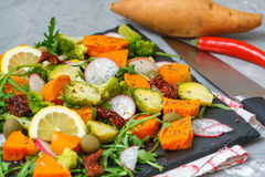 Baked sweet potato, broccoli and other vegetables salad stock photo