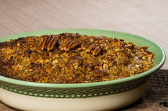 Baked sweet potato casserole with pecan topping Stock Image