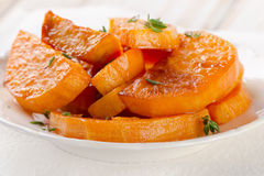 Baked sweet potato wedges with  thyme Stock Photo