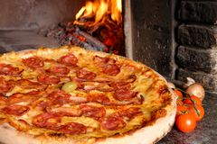 Baked tasty pizza with salami and bacon Stock Image