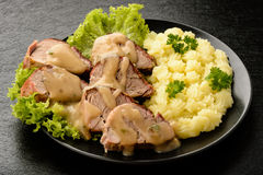 Baked tenderloin with mushroom sauce and mashed potatoes. Stock Images