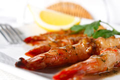 Baked Tiger Shrimps with Greens and Lemon Royalty Free Stock Photo
