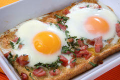 Baked toast with eggs and ham Royalty Free Stock Images