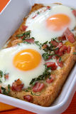 Baked toast with eggs and ham Stock Photos