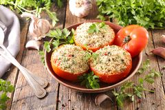 Baked tomato with crumb. On wood royalty free stock photo