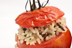 Baked Tomato Stuffed With Rice. Closeup of one baked tomato stuffed with rice for vegetarians Stock Photos