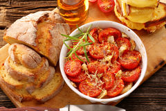 Baked tomatoes, corn bread and sandwiches with melted cheese Stock Images