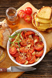 Baked tomatoes, corn bread and sandwiches with melted cheese.  Stock Photos