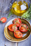 Baked tomatoes. With herbs and garlic Stock Images