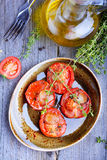 Baked tomatoes. With herbs and garlic Stock Photos
