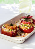 Baked tomatoes with savory stuffing Stock Image