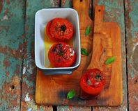 The baked tomatoes stuffed with a cod on Stock Images