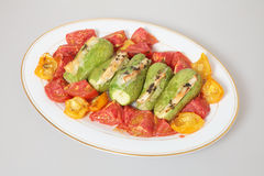 Baked tomatoes and stuffed courgettes Royalty Free Stock Image