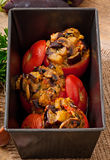 Baked tomatoes stuffed with eggplant and mushrooms Royalty Free Stock Photo