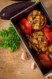 Baked tomatoes stuffed with eggplant and mushrooms Stock Image
