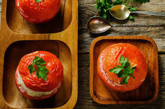 Baked tomatoes stuffed fish Stock Image