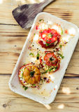 Baked tomatoes stuffed with herbal grains Royalty Free Stock Photography