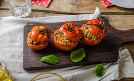Baked tomatoes stuffed with herbs. Delicious vegetarian meal Stock Image