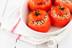 Baked Tomatoes Stuffed with Rice and Beef Mince stock photos