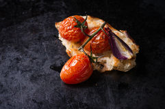 Baked tomatoes with toasted bread Royalty Free Stock Images