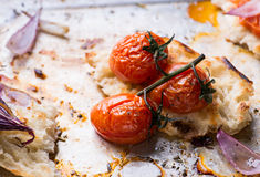 Baked tomatoes with toasted bread Stock Images