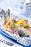 Baked trout. Trout baked with onion and lemon in foil Royalty Free Stock Photos