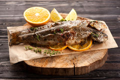 Baked trout fish with orange and thyme Royalty Free Stock Photo