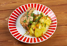 Baked trout with potatoes Stock Photos