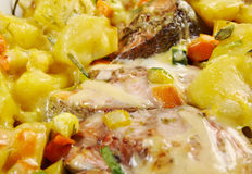 Baked trout with potatoes Royalty Free Stock Image