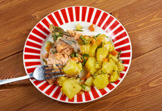 Baked trout with potatoes stock photography