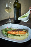 Baked trout with sauce and broccoli Royalty Free Stock Images