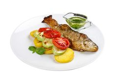 Baked trout with vegetables royalty free stock image