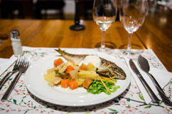 Baked trout with vegetables Stock Images