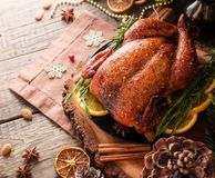 Baked turkey for Christmas Dinner or New Year space for text. Roast chicken or turkey for Christmas Dinner and New Year with mulled wine and Christmas royalty free stock image