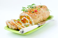 Baked turkey roll stuffed with dried apricots, cherries and pist Royalty Free Stock Photo