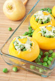 Baked turnips, stuffed with green peas and cheese Stock Photography