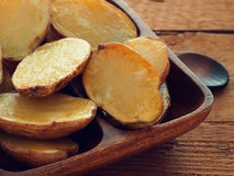 Baked unpeeled potatoes Royalty Free Stock Images