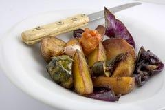 Baked vegetable dish. On white background royalty free stock image