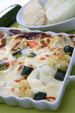 Baked vegetable in white creamy sauce Stock Photos